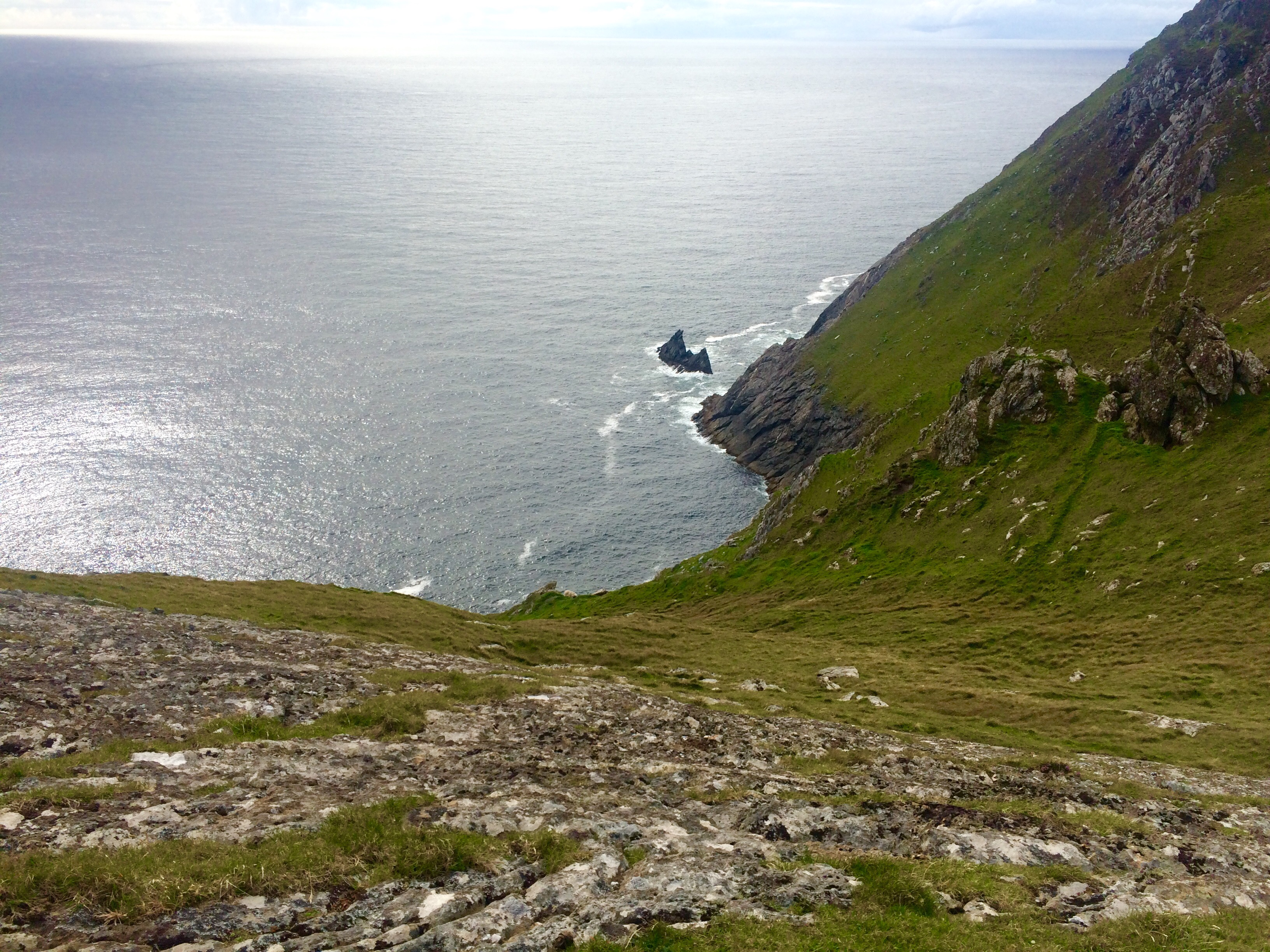 View west down the cliffs from the cache site