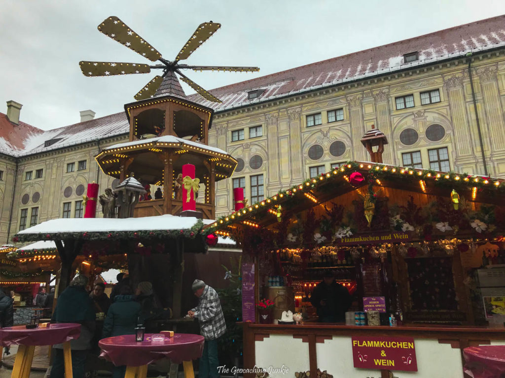 A Christmas pyramid sits high above the market at Residenz in Munich, Germany